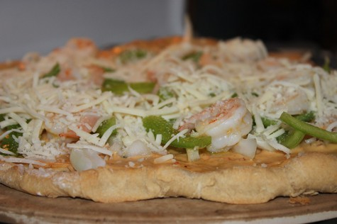 Top shrimp pizza with mozzarella cheese.