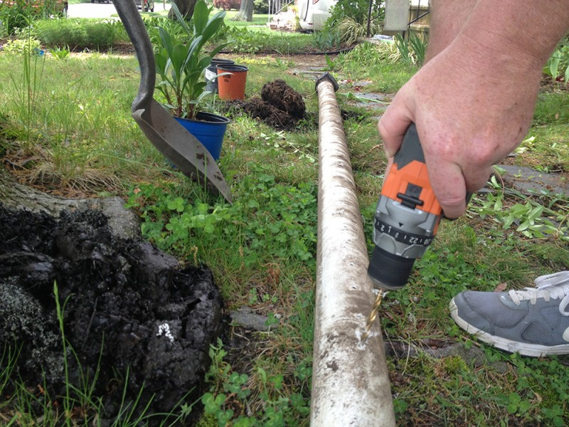drilling holes for our rain gutter watering system
