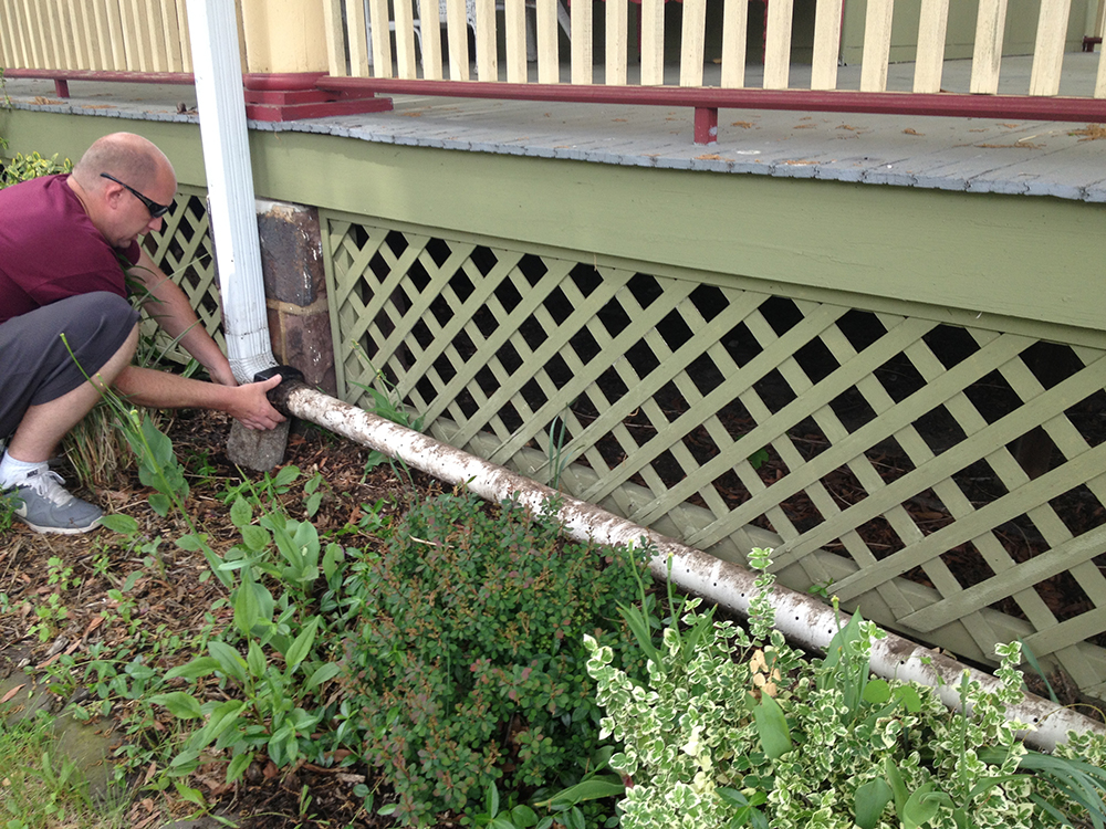 Diy Rain Gutter Watering System Turn Your Gutter Into A