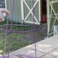 DIY Tomato Cage Project. Transform an old wire tomato cage into a colorful piece of art!