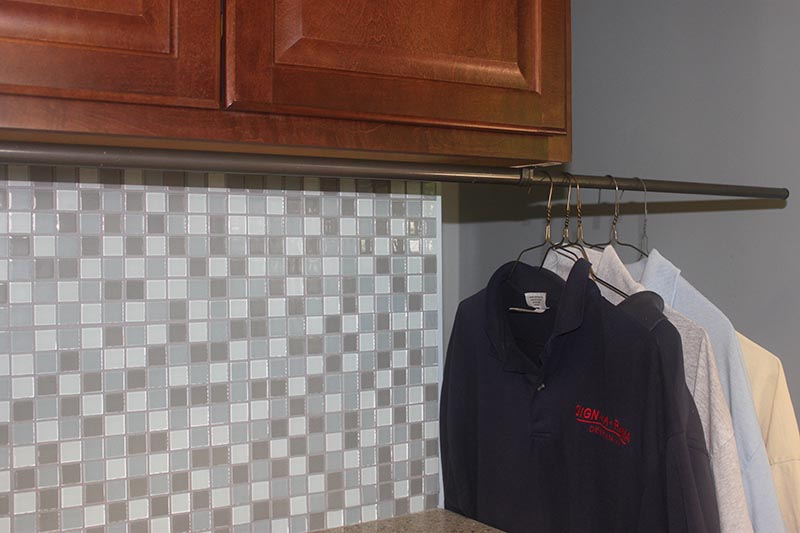 Cheap DIY Clothes Rack- Laundry Room Pull-Out Clothes Hanging Rod ...