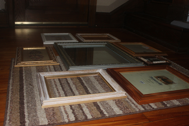 Easy DIY Gallery Wall with cheap mismatched yard sale frames